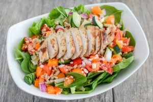 This quick and flavorful salad makes a wonderful fitness meal since it's filled with fiber, protein and satisfying flavor. Use the dressing recipe below whenever salad is on the menu for dinner.